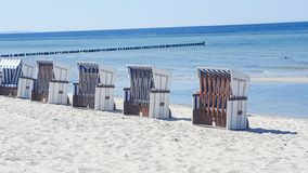 Row of beach chairs on the Baltic Sea beach Stock Images