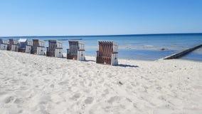 Row of beach chairs on the Baltic Sea beach Stock Photo
