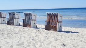 Row of beach chairs on the Baltic Sea beach Stock Photography