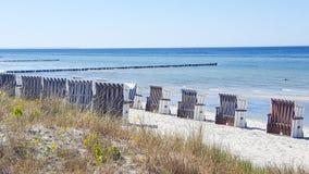Row of beach chairs on the Baltic Sea beach Royalty Free Stock Photo