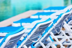 Row of beach chairs and swimming pool Royalty Free Stock Photos
