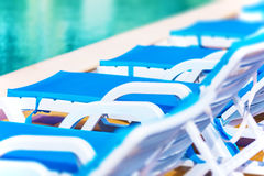 Row of beach chairs and swimming pool Stock Photos
