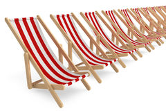 Row of Beach chairs with white and red stripes Stock Images