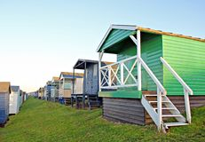 Row of beach huts Stock Images