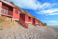 Row of beach huts in Branscombe. Row of beach huts in village of Branscombe on the Jurassic Coast, Devon Stock Image