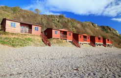 Row of beach huts in Branscombe. Row of beach huts in village of Branscombe on the Jurassic Coast, Devon Stock Photography