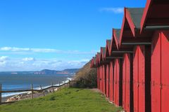Row of beach huts in Branscombe. Row of beach huts in village of Branscombe on the Jurassic Coast, Devon Royalty Free Stock Image