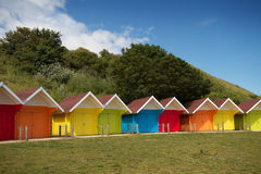 Row of beach huts on bright summer day royalty free stock photo