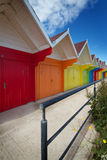 Row of beach huts on bright summer day Stock Photos