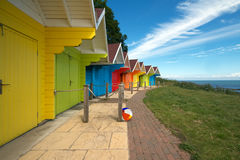 Row of beach huts on bright summer day Stock Photo