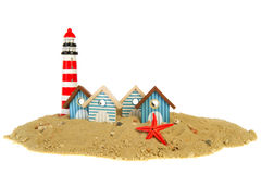 Row beach huts with lighthouse Royalty Free Stock Image