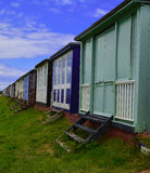 Row of beach huts rear view Stock Image