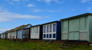 Row of beach huts rear view Stock Images
