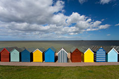 Row of beach huts on summer day in Kent, England. Seaside perfection in Kent, England Royalty Free Stock Photos