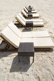 Row of Beach Loungers. Rows of several lounge chairs on the beach Stock Images