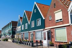 A row of beautiful houses by the sea in Holland. They are orderliness and beautiful royalty free stock image
