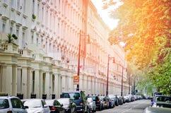 Row of beautiful white edwardian houses in Kensington, London Stock Images