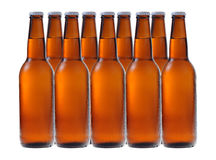 A row of beer bottles Stock Image