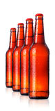 Row of beer Bottles with drops  Royalty Free Stock Photo