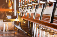 Row of beer faucets Royalty Free Stock Photos