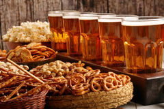 Row of beer glasses and snacks on wooden background football fan Royalty Free Stock Image