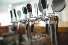 Row of beer taps at cafe Royalty Free Stock Photography