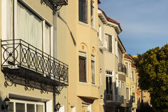 A row of beige upscale houses against blue sky Stock Photography