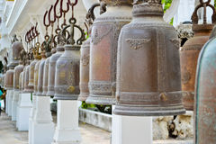 Row of bells. Buddhist ceremonial bells at the temple of Wat Phra Buddha Bat Royalty Free Stock Photography
