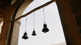 Row of bells in the ancient temple. In 4K stock footage