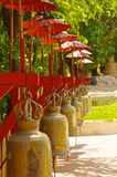Row of bells in a buddhist temple of Thailand Stock Image