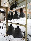 Bells of various sizes. A row of bells of several different sizes in the monastery courtyard on a winter day royalty free stock photography