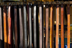 Row of belts. Row of leather belts hanging in the market royalty free stock images