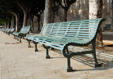 A row of benches. Along the Siracusa's harbor Royalty Free Stock Photography