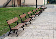 Row of benches in the courtyard Royalty Free Stock Photo