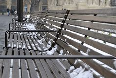 Row of the benches in the prespective with blurred background stock photos