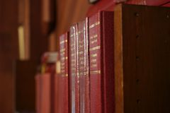 Row of Bibles. In Old St Marys, Parnell, Auckland, New Zealand Royalty Free Stock Photography