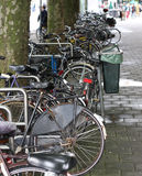 Row of bicycles. A line of European-style bicycles parked on a street Stock Photography