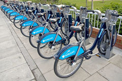 Bicycles for Hire, London. Row of bicycles at one of many docking stations in London for the cycle hire scheme sponsored by Barclays Bank. They are known as royalty free stock photos