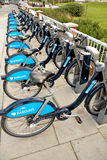 Bicycles for Hire, London. Row of bicycles at one of many docking stations in London for the cycle hire scheme sponsored by Barclays Bank. They are known as royalty free stock photo