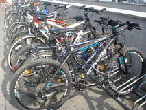 Row of bicycles parked outdoor in Bucharest, Romania, on July 1, 2015 Royalty Free Stock Photography