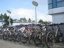 Row of bicycles parked outdoor in Bucharest, Romania, on July 1, 2015 Royalty Free Stock Image