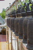 Row of big brass bell in temple, Thailand Stock Image