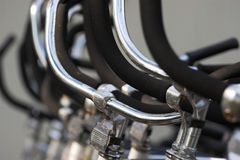 Row of bike handlebars Royalty Free Stock Images