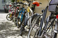 Row of Bikes. Bikes Parked in a Street of Berlin Royalty Free Stock Photography