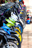 Row of Bikes. Row of Motorcycles Parked on Street and Row of Helmet Royalty Free Stock Photo