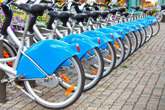 Row of bikes / bicycles. Row of parked bikes / bicycles in a city center as an eco friendly public transport system. These were in Gothenburg, Sweden royalty free stock photos