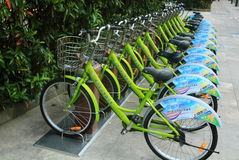 Row of bikes / bicycles. Row of parked bikes / bicycles in a city center as an eco friendly public transport system. These were in shanghai Royalty Free Stock Photo