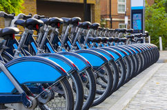 Row of bikes for hire. City Bike Rental - Stock Image, a row of bikes for hire as part of a new scheme to encourage pedal power in the City of London. The aim is Royalty Free Stock Photography