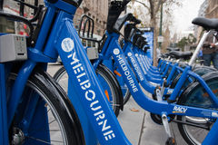 Row of bikes - Melbourne Bike Share scheme. 'Common Bike' Melbourne Bike Share scheme in July 2010. Recently installed, but controversy over low usage due to Royalty Free Stock Images