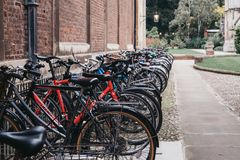 A row of bikes parked on the street in Cambridge, UK Royalty Free Stock Images